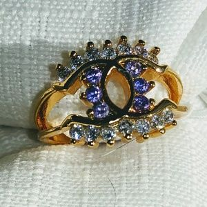 Unique amethyst and white topaz ring